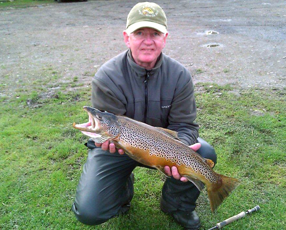 Stuart Marshall with his 6 lbs 10 ozs Loch Leven brownie